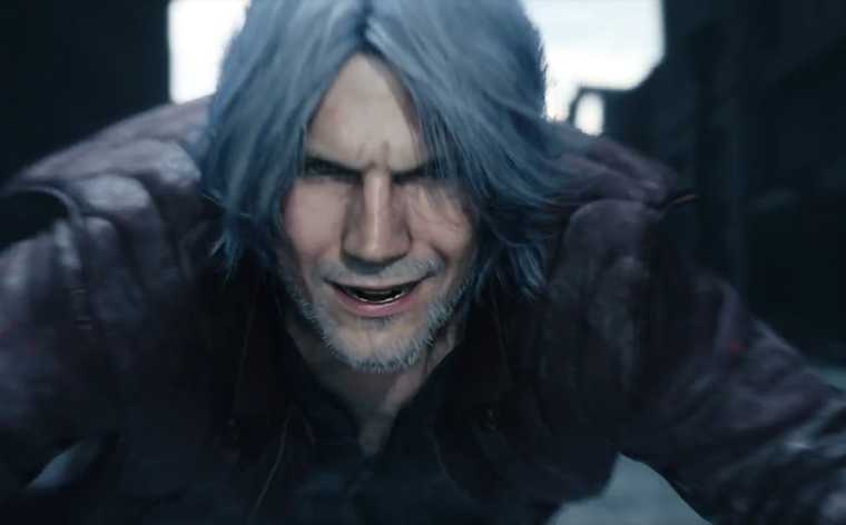 Screenshot from E3 2018's Devil May Cry 5 trailer by Capcom. Close up of grizzled, older male character, smiling maniacally.