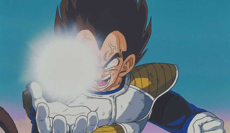 Vegeta channels bright, glowing energy in his palm